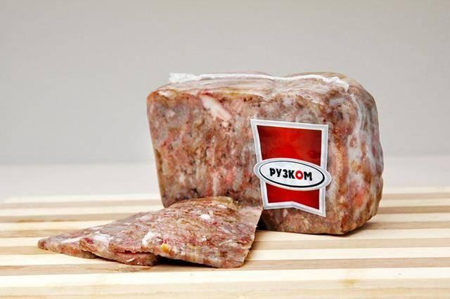 Мясо из свиных голов прессованное в/у